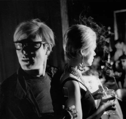 Andy Warhol and Edie Sedgwick at a party. Photo by Bob Adelman.